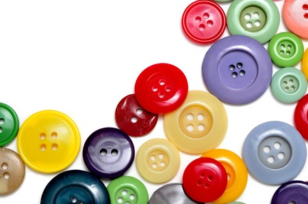 sewing buttons: buttons of many colors on a white background