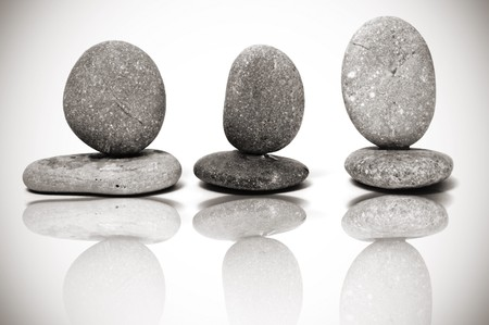 some piles of zen stones reflected on the background photo