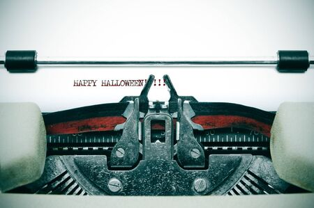 vignetting: happy halloween written with an old typewriter
