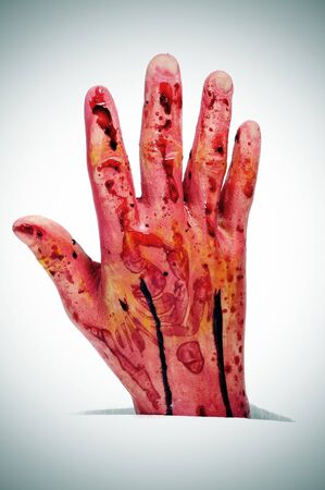 an scary bloody hand for Halloween holiday photo