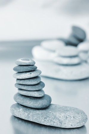 a pile of zen stones in black and white photo