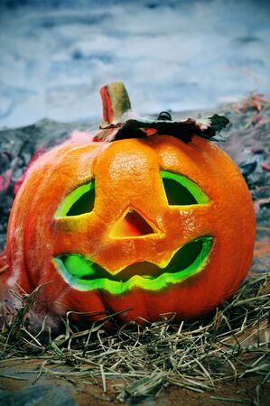 closeup of a jack-o'-lantern in a cemetery for Halloween Stock Photo - 7974822