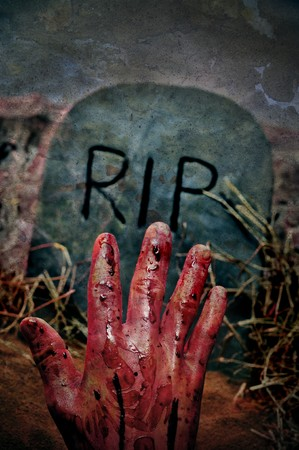 closeup of a grave with a bloody hand in a cemetery for Halloween Stock Photo - 7985090