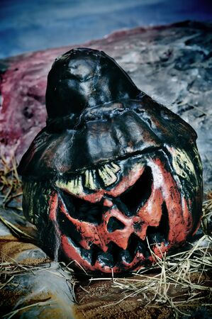 closeup of a jack-o'-lantern in a cemetery for Halloween Stock Photo - 8020609