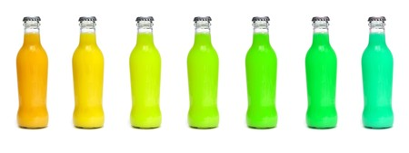 some juice bottles of different colors on a white background Stock Photo - 8027179