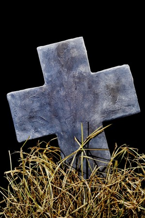 closeup of a stone cross in a cemetery for Halloween photo