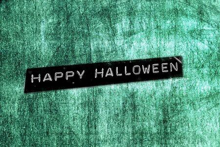 embossing: happy halloween written in an embossing tape