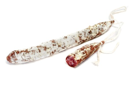 llonganissa: a pair of fuets, spanish salami, isolated on a white background