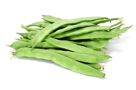 a pile of raw french beans isolated on a white background photo