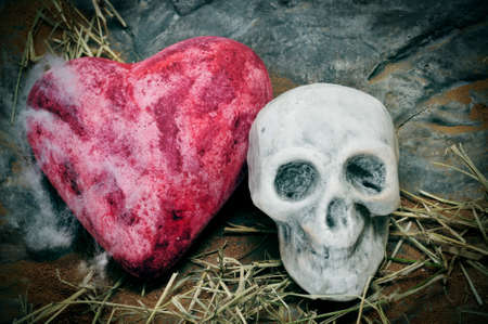 a skull and a heart on a scary background for Halloween photo