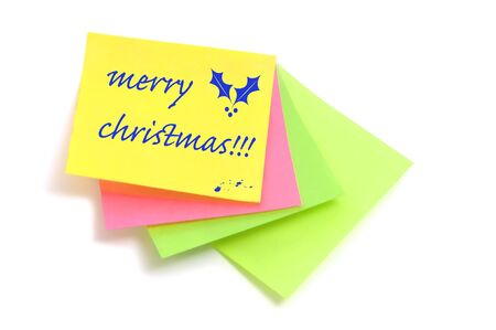 merry christmas written in post notes of different colors photo