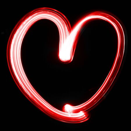 a red heart drawn on a black background