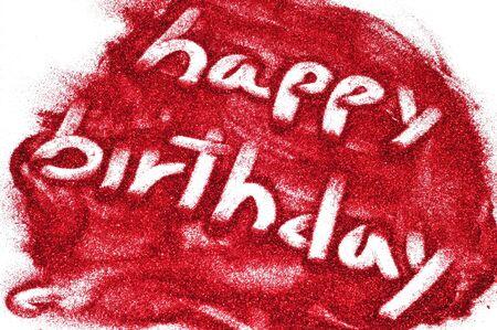 sentence happy birthday written on red glitter photo