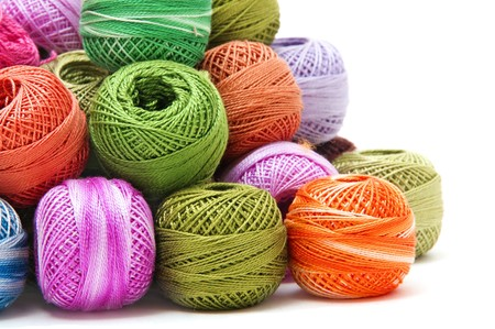 knit stitch: spools of many colors on a white background Stock Photo