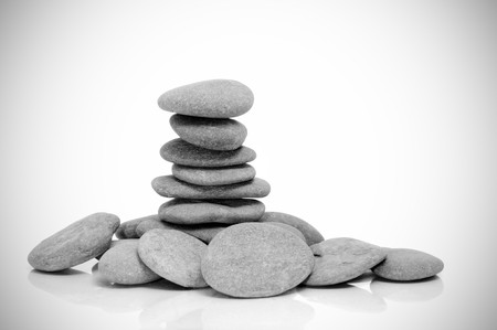 a pile of zen stones on a white vignetted background Stock Photo - 8126805