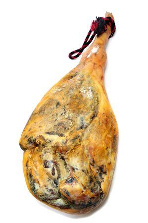 prosciutto: a leg of spanish serrano ham on a white background