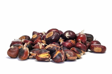 buckeye seed: some roasted chestnuts isolated oin a white background