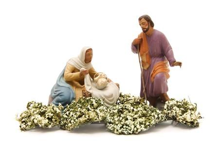 presepio: figures representing nativity scene on white background