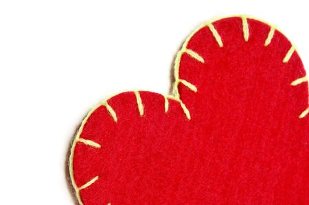 closeup of a textile heart on a white background  photo