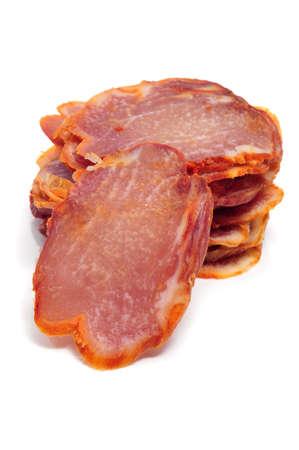 embutido: spanish chorizo slices isolated on a white background