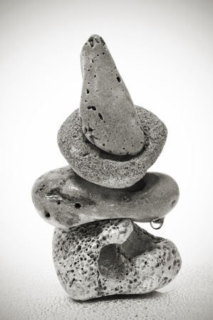 a pile of zen stones on a vignetted background photo