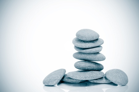 yoga rocks: a pile of zen stones on a vignetted background Stock Photo