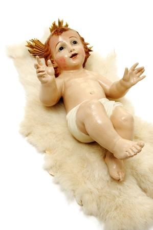 figure of child jesus on white background photo
