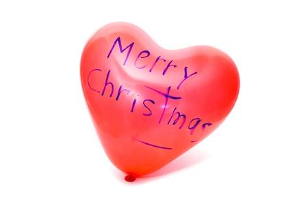 merry christmas written in a heart-shaped balloon Stock Photo - 8249870