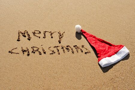 sentence merry christmas written in the sand Stock Photo - 8290781