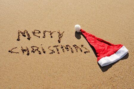 sentence merry christmas written in the sand Stock Photo - 8290781