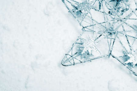 a silver christmas star on the snow Stock Photo - 8290783