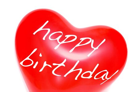 creativity symbol: happy birthday written in a heart-shaped balloon on a white background Stock Photo