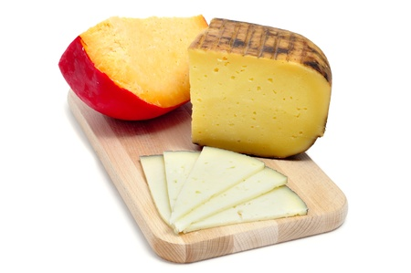 different kinds of cheese on a cutting board isolated on a white background photo