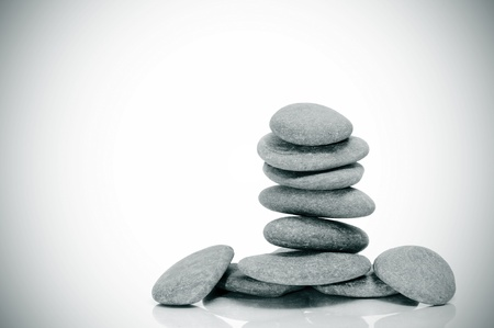 a pile of zen stones on a white vignetted background photo
