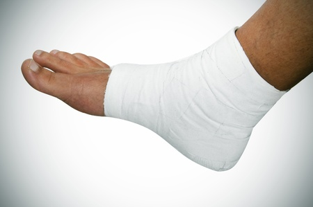 a bandaged foot on a white vignetted background Stock Photo - 8327161