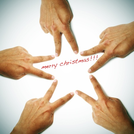 merry christmas written on a white background with hands drawing a star Stock Photo - 8327179