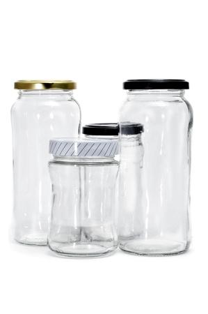 jarra: Algunos frascos de vidrio vac�a aislados en un fondo blanco Foto de archivo