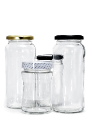 some empty glass jars isolated on a white background photo