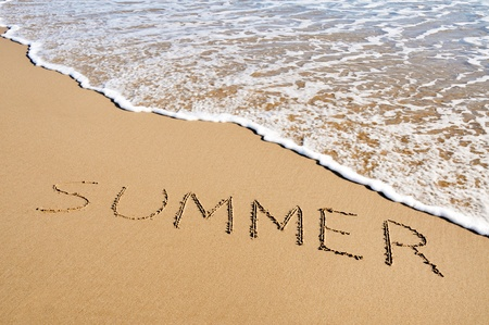 word summer written in the sand of a beach Stock Photo - 8327246