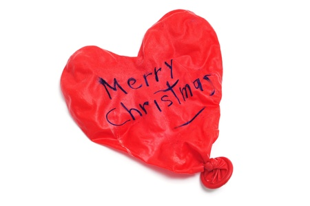 merry christmas written in a heart-shaped deflated balloon Stock Photo - 8364972