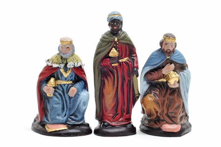 presepio: figures representing the three kings in a nativity scene on white background Stock Photo