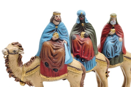 three wise men: figures representing the three kings in a nativity scene on white background Stock Photo