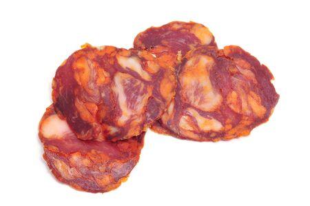 red spanish chorizo slices on a white background Stock Photo - 8399680