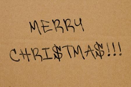 sentence merry christmas written in a brown cardboard photo