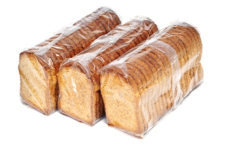 wheat toast: some packs of bread rusks isolated on a white background