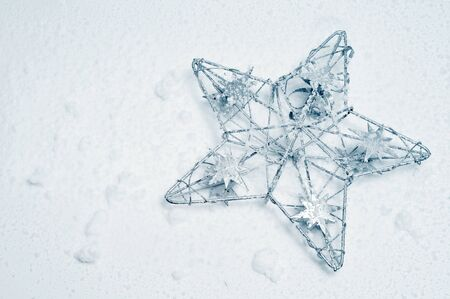 a christmas star on a snow background  photo