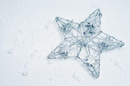 a christmas star on a snow background  photo