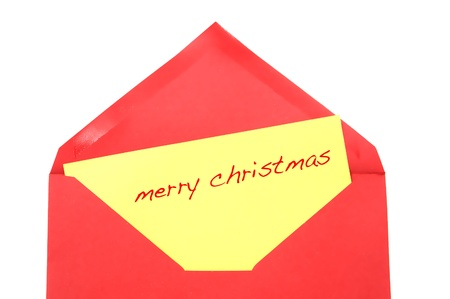 hogmanay: merry christmas written on a yellow postcard inside a red envelope Stock Photo