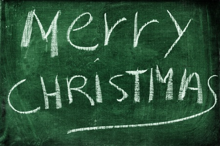 wrote: merry christmas with chalk on a blackboard Stock Photo