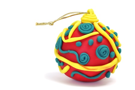 modelling clay: a christmas ball made with modelling clay on a white background